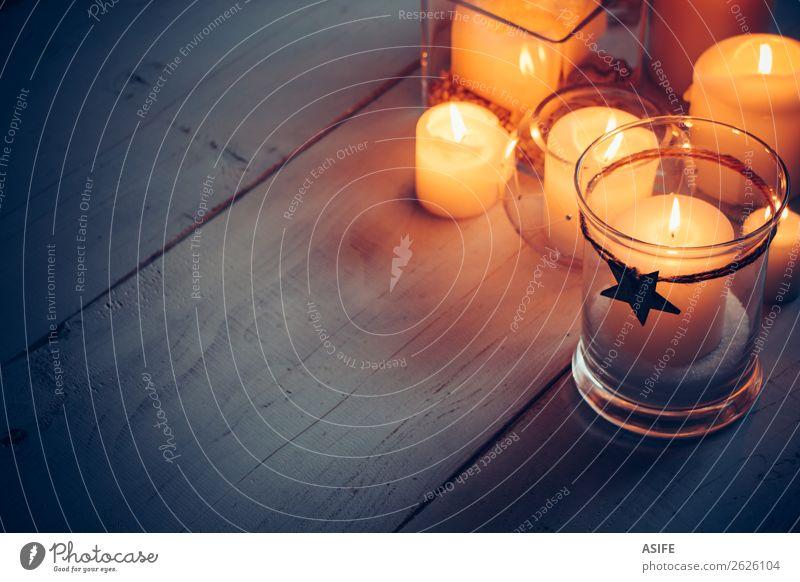Weihnachtskerzen in der Nacht Dekoration & Verzierung Tisch Feste & Feiern Weihnachten & Advent Wärme Kerze Holz Ornament glänzend dunkel einfach hell blau gelb