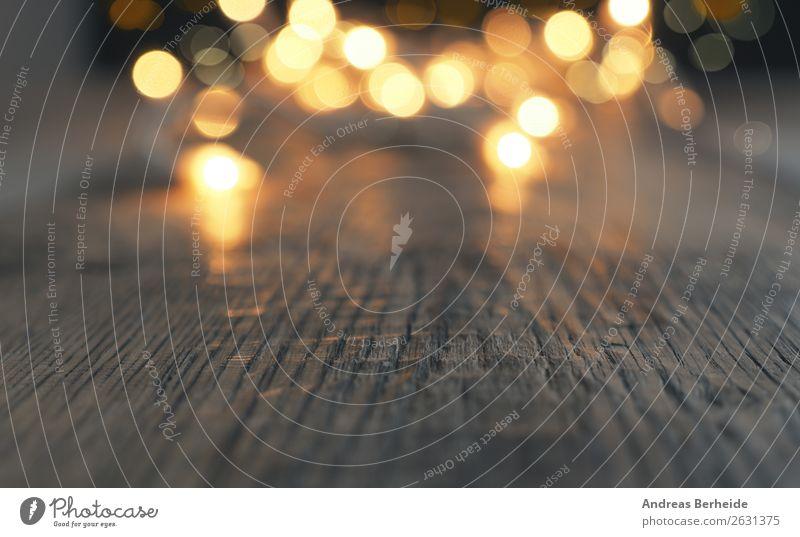 Lichterkette auf Holzfußboden Design Dekoration & Verzierung Weihnachten & Advent gelb Hintergrundbild defocused glitter glow gold golden holiday light new