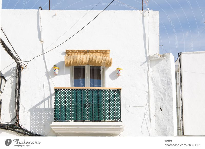 Facades of spanish houses Sommer Wohnung Hochhaus Fassade alt einzigartig Andalusia Balcony Green white striped Spain blinds Blauer Himmel building copy space