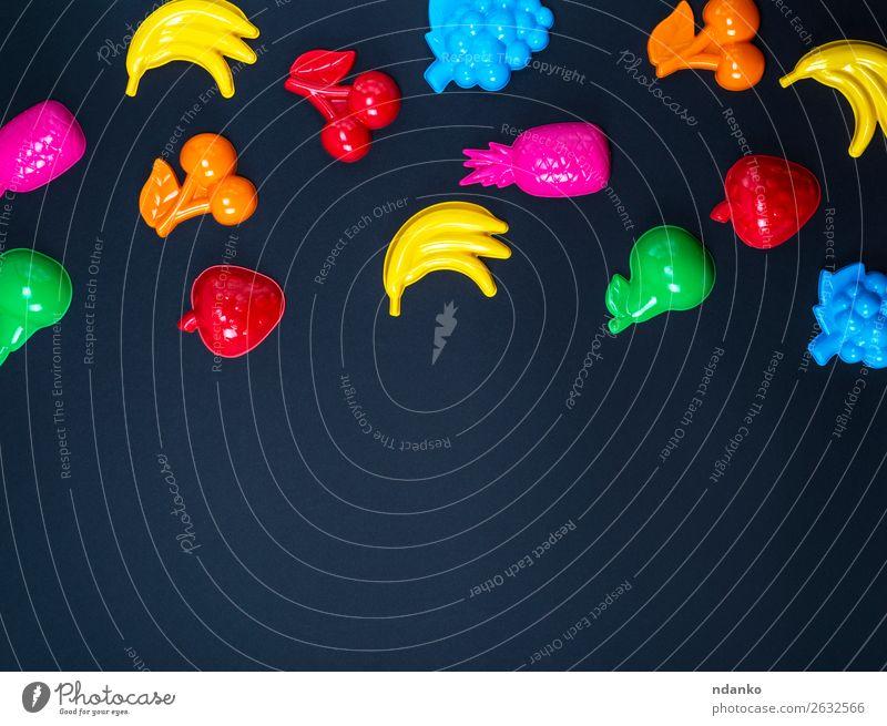 schwarzer Hintergrund mit bunten Spielzeugen für Kinder Frucht Apfel Design Freude Spielen Dekoration & Verzierung Sammlung Kunststoff hell niedlich oben blau