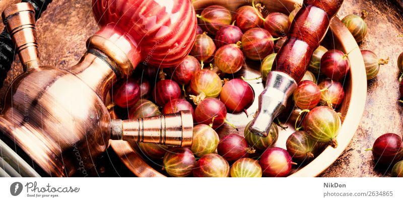 Östliche Shisha mit Stachelbeere Wasserpfeifenrauch Tabak Beeren kalianisch Rauch Stachelbeeren shisha Osten Nikotin Rauchen Erholung Frucht arabisch Mundstück