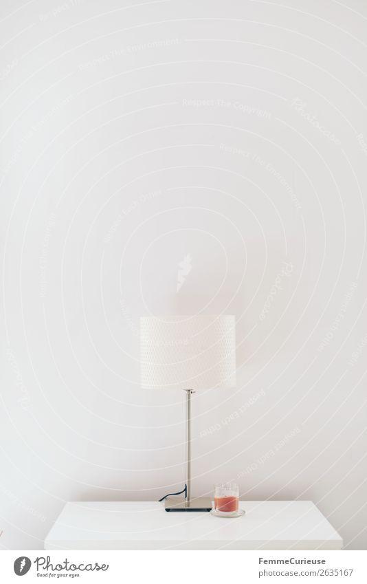 Lamp & candle on white chest of drawers Lifestyle Häusliches Leben minimalistisch Lampe Kerze Kommode Tischlampe weiß hell leer Sideboard Wand Farbfoto
