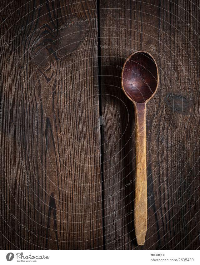 sehr alter leerer Holzlöffel Löffel Tisch Küche Werkzeug groß natürlich retro braun Farbe Tradition verwendet schöpfen Essen zubereiten Utensil Hintergrund