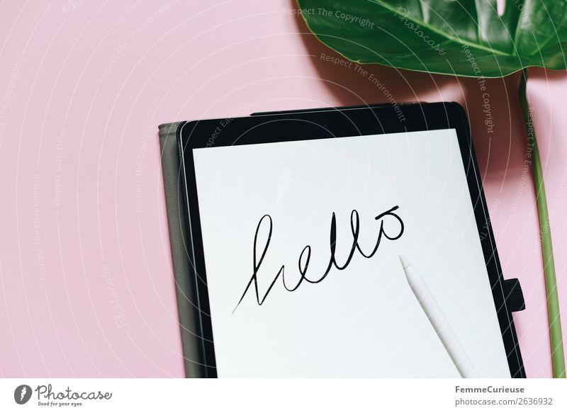 """Tablet with a handwritten """"hello"""" on pink background Technik & Technologie Unterhaltungselektronik Fortschritt Zukunft Schreibwaren Papier Kreativität Hallo"""