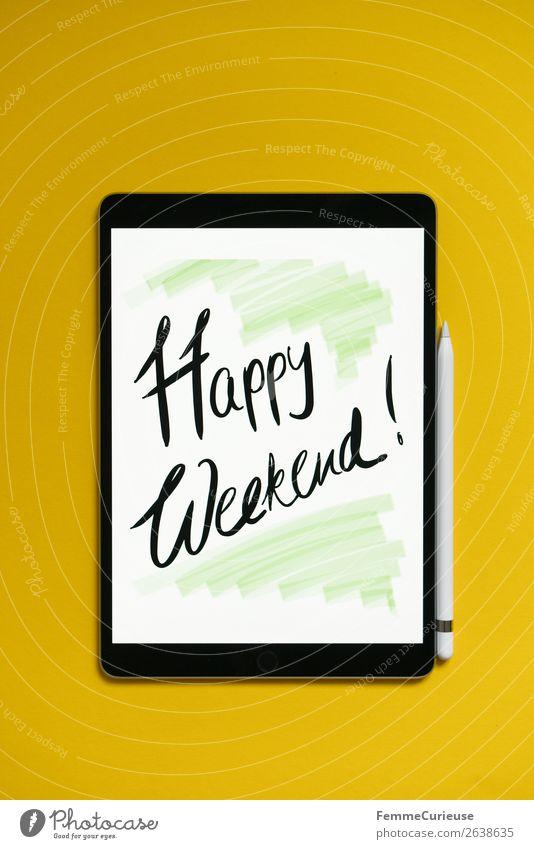 """Tablet with a handwritten """"Happy Weekend!"""" on yellow background weiß gelb Schriftzeichen Technik & Technologie Kreativität Zukunft Wunsch digital Fortschritt"""