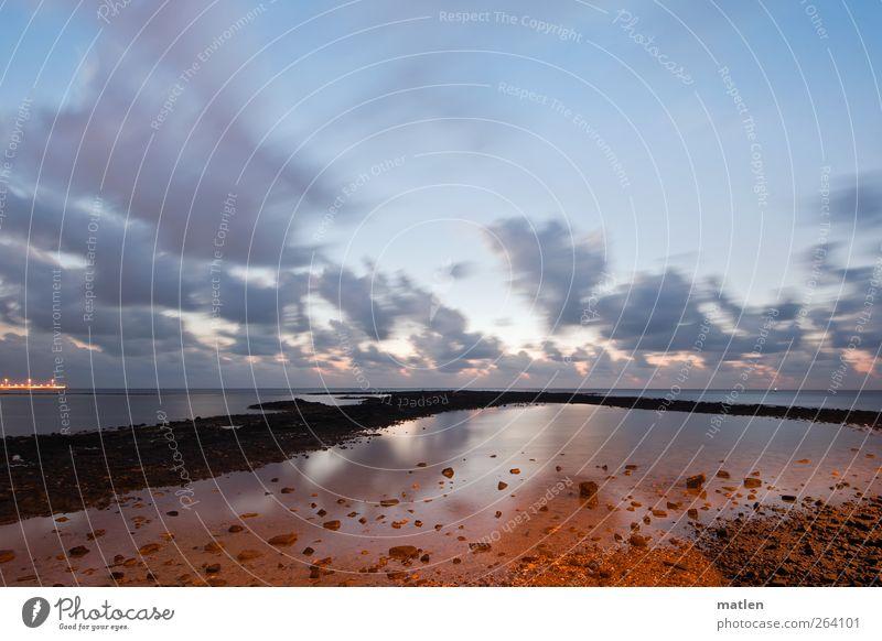 frühestens Himmel Wolken Sonnenaufgang Sonnenuntergang Sonnenlicht Küste Meer Menschenleer blau braun Ferne Anlegestelle Reflexion & Spiegelung Morgenrot Stein