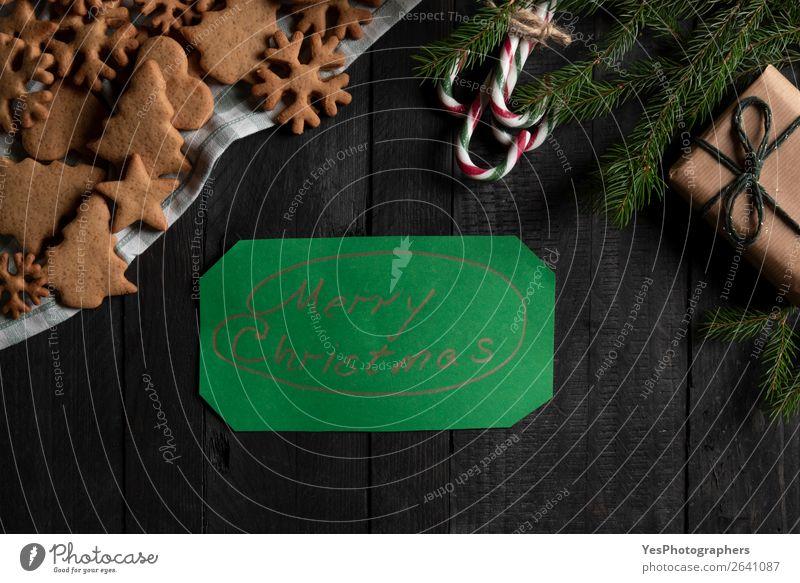 Frohe Weihnachtsbotschaft auf Grünbuch. Weihnachtsgeschenk und Cookies Süßwaren Dekoration & Verzierung Feste & Feiern Weihnachten & Advent Fröhlichkeit