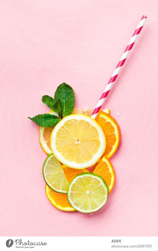 Lustiges Saftkonzept Frucht Ernährung Getränk Limonade Sommer Kind Blatt Tropfen frisch lustig oben gelb grün rosa Idee Kreativität Zitrone Kalk orange