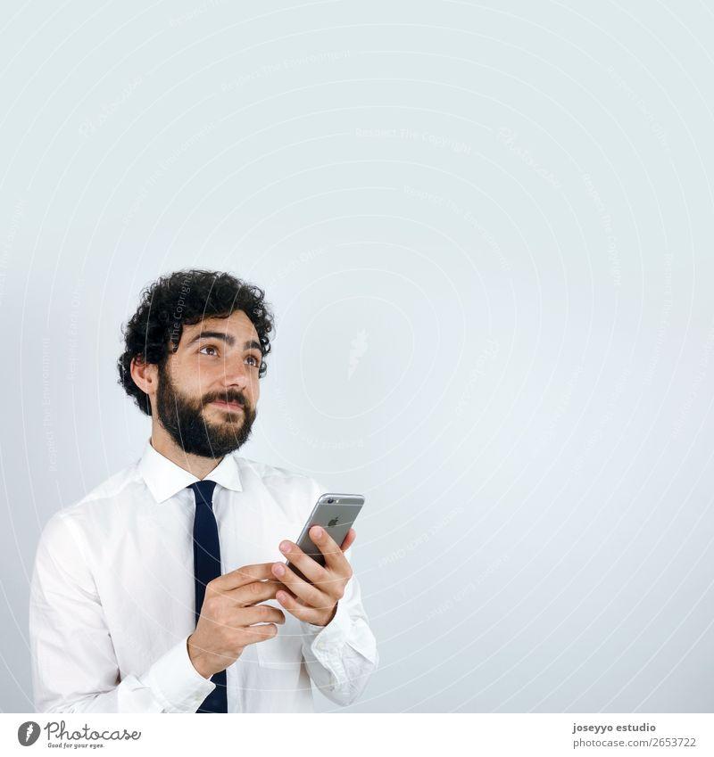Geschäftsmann mit Handy in der Hand Dienstleistungsgewerbe Post Telekommunikation Business Unternehmen Erfolg sprechen PDA Technik & Technologie Mann Erwachsene