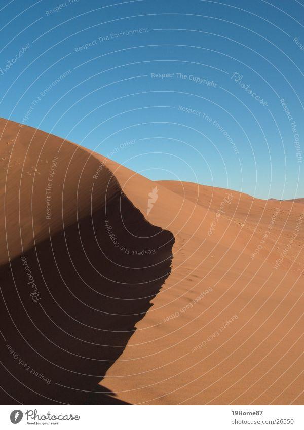 Big Ben Physik Sonnenaufgang Licht Afrika gelb Ecke Horizont aufsteigen Wüste Erde Sand Stranddüne Wärme Tod Schatten blau beschwerlich