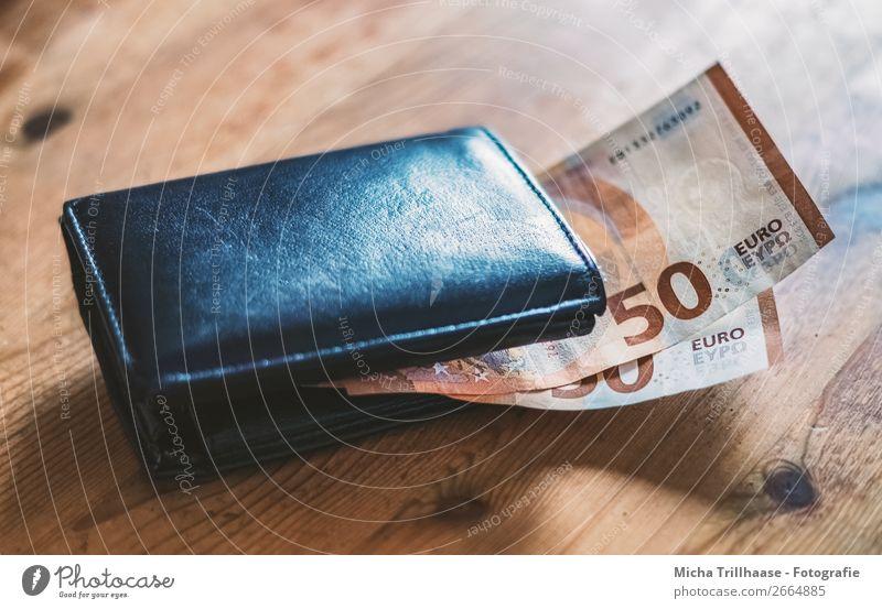 Brieftasche mit Geldscheinen Arbeit & Erwerbstätigkeit Portemonnaie Eurozeichen bezahlen kaufen sparen Armut Billig reich blau gelb orange schwarz sparsam