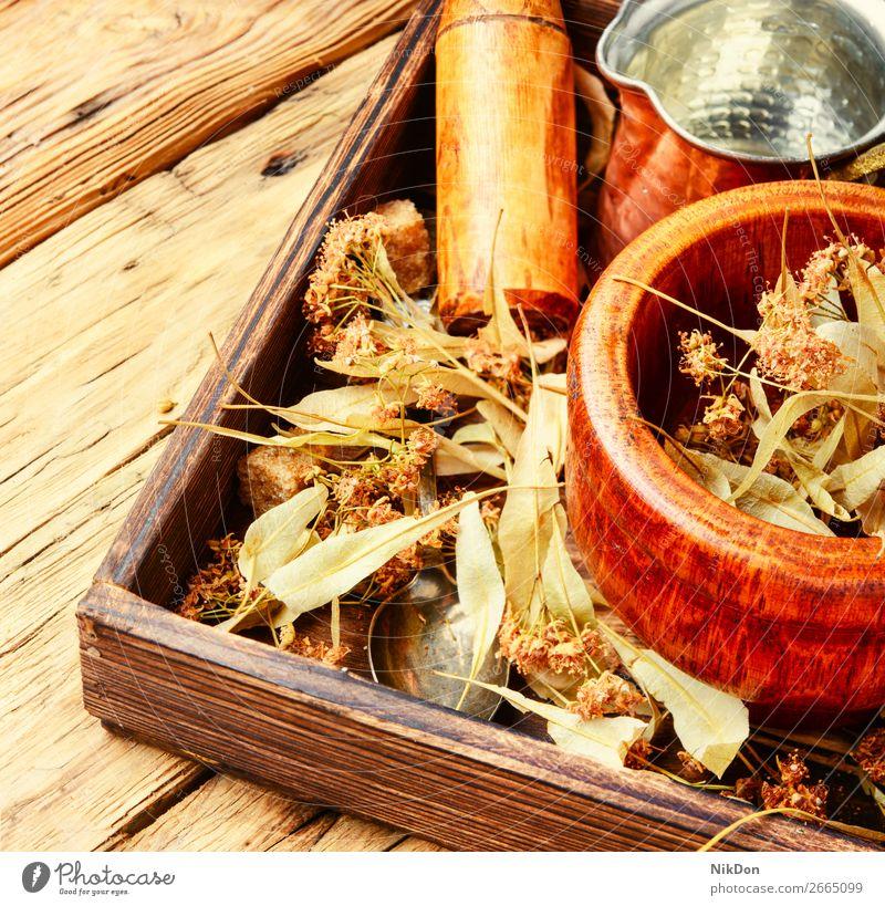 Trockenes Lindenblatt Kraut Pflanze Kasten medizinisch Tee Gesundheit Blatt alternativ Minenwerfer Stössel Homöopathie Heilung Therapie geblümt Kalk Getränk