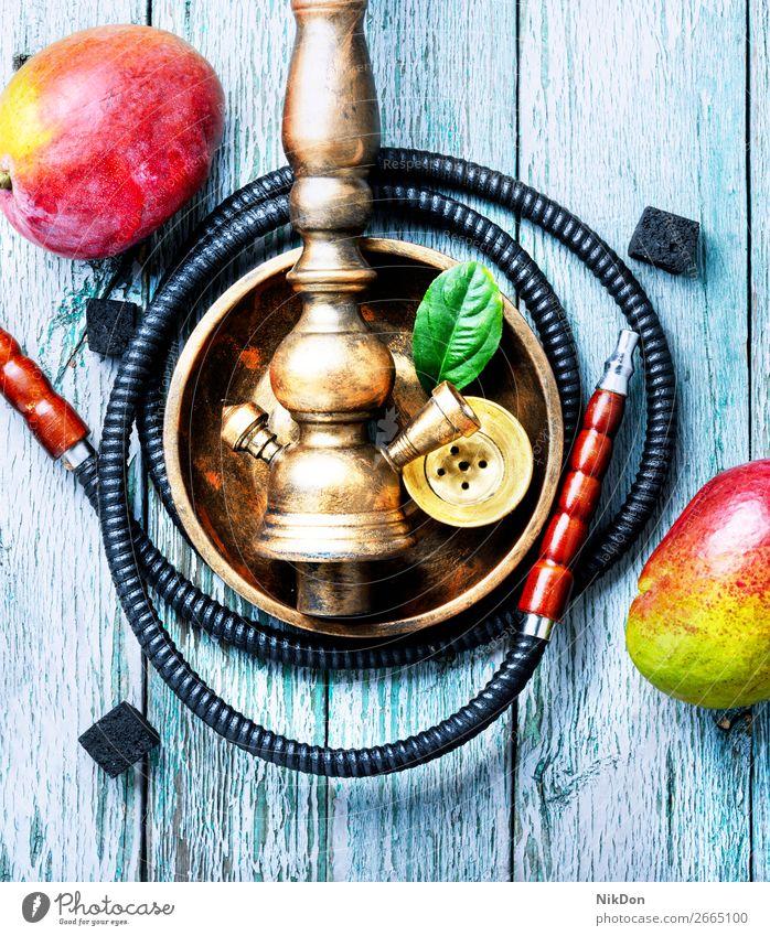 Wasserpfeife mit Mango zum Entspannen Wasserpfeifenrauch Tabak Rauchen shisha Shisha rauchen Frucht Mundstück Vergnügen Erholung Wasserpfeifen-Lounge arabisch