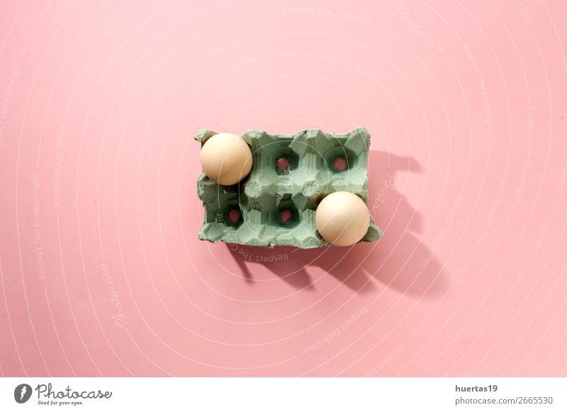 Frische Eier auf rosa Hintergrund Lebensmittel Frühstück Gesunde Ernährung frisch lecker natürlich oben gelb Proteine Hähnchen organisch Gesundheit Bauernhof