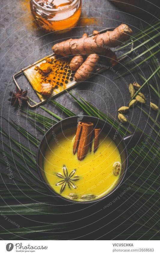 Tasse mit goldenem Gelbwurzel Milch und Gewürzen Lebensmittel Kräuter & Gewürze Ernährung Bioprodukte Vegetarische Ernährung Diät Getränk Heißgetränk Tee Design
