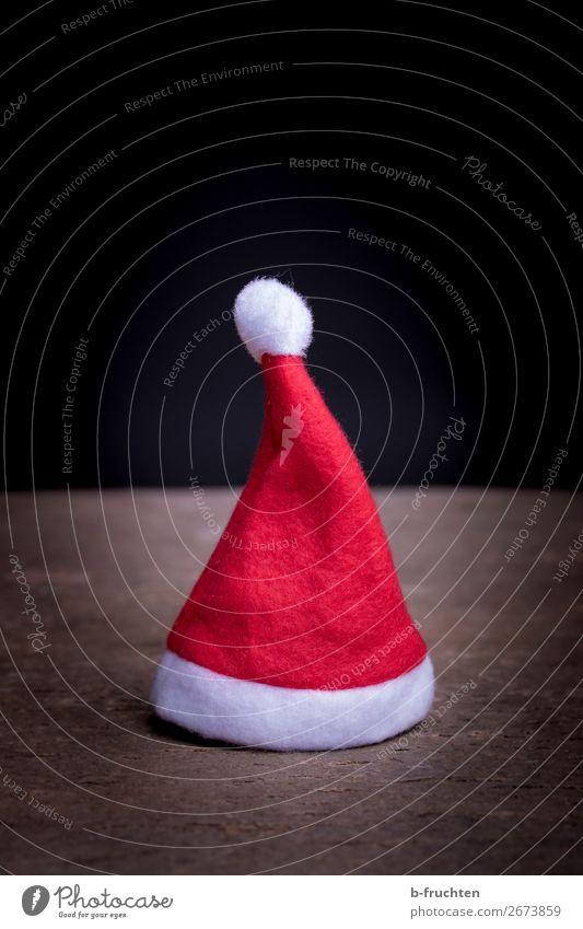Mütze vom Weihnachtsmann Entertainment Veranstaltung Feste & Feiern Weihnachten & Advent außergewöhnlich dunkel rot Erwartung Handel sparsam Nikolausmütze