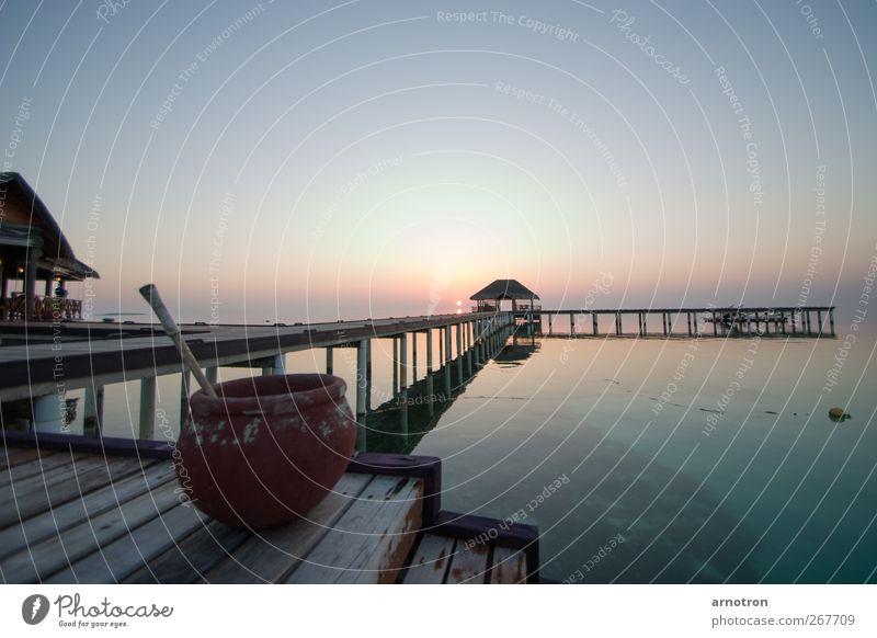 Sonnenuntergang im Paradies Wasser Ferien & Urlaub & Reisen Meer Sommer Einsamkeit Ferne Landschaft Wärme Holz Küste Horizont Schwimmen & Baden außergewöhnlich