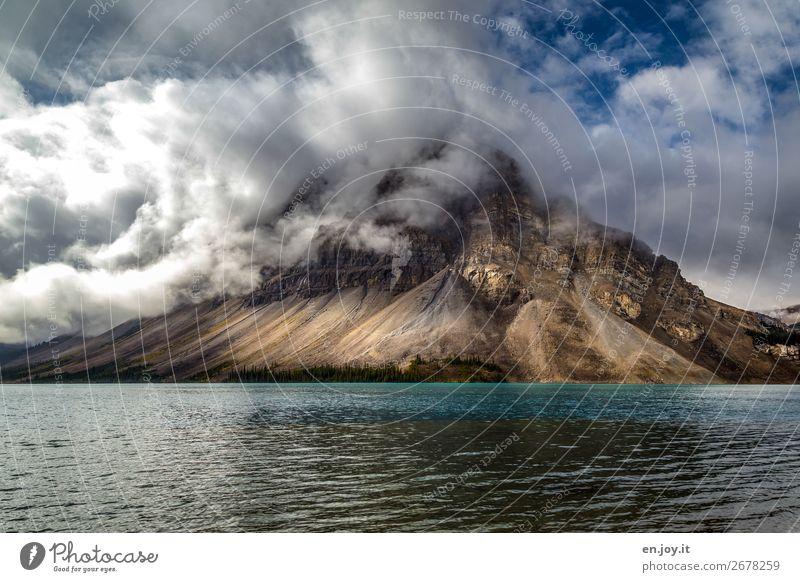 Mount Crowfoot Ferien & Urlaub & Reisen Ausflug Berge u. Gebirge Natur Landschaft Wolken Klima Klimawandel Rocky Mountains See Bow Lake Tourismus Umwelt Kanada