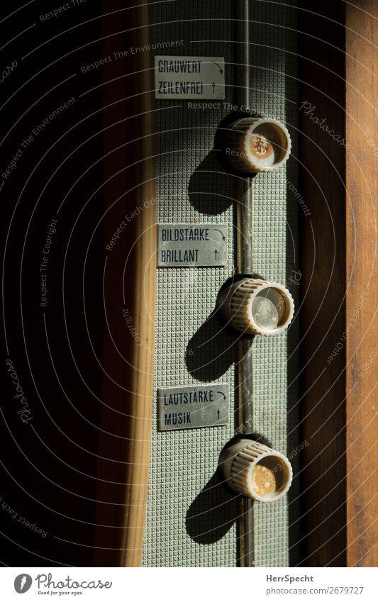 Mal wieder an den Reglern dreh'n... Fernseher Holz Kunststoff Schriftzeichen alt authentisch historisch retro rund braun grau Drehregler Lautstärke Bildschirm