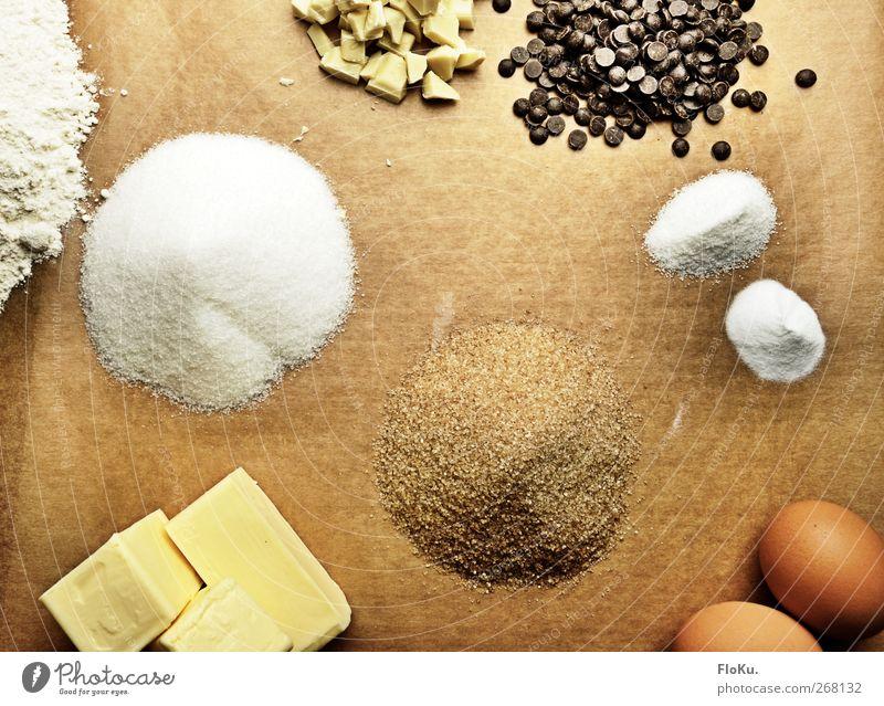 Backvorbereitungen weiß gelb Ernährung Lebensmittel braun süß Kochen & Garen & Backen Küche Süßwaren lecker Ei Schokolade Zucker ungesund Zutaten Mehl