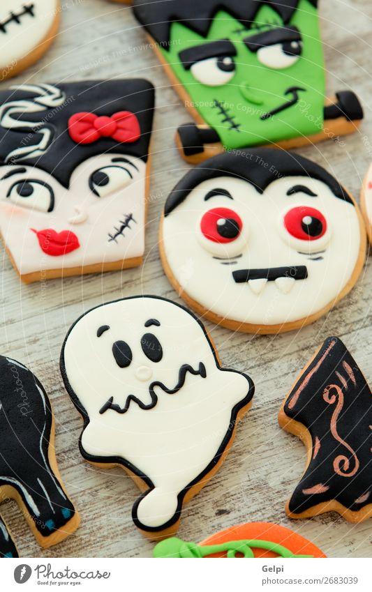 Halloween-Kekse mit verschiedenen Formen Dessert Freude Gesicht Dekoration & Verzierung Tisch Feste & Feiern Herbst Holz Lächeln gruselig lecker braun schwarz