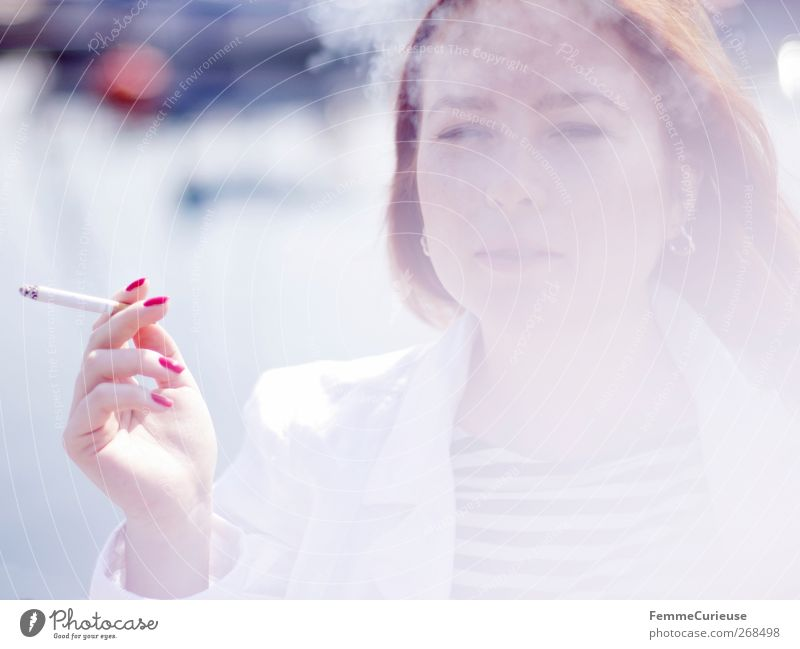 Taking a cigarette break I. Junge Frau Jugendliche Erwachsene Kopf Hand Finger 1 Mensch 18-30 Jahre Erholung Zigarette Zigarettenrauch Rauchen Tabakwaren rot