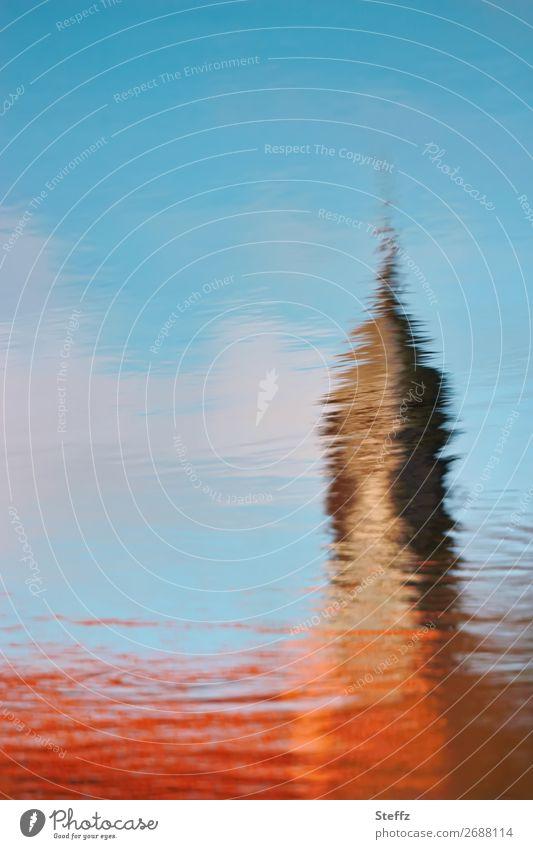 Kirchturm Landschaft Wasser Himmel Schönes Wetter Teich Kirche Burg oder Schloss Turm Bauwerk Kirchturmspitze Mauer Wand schön blau braun orange