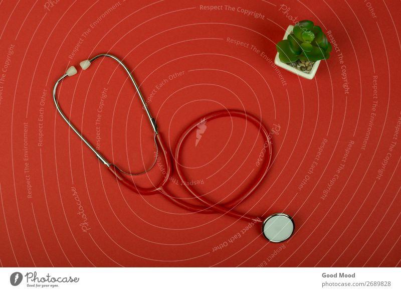 Draufsicht rotes Stethoskop auf rotem Papiergrund Gesundheitswesen Behandlung Krankheit Medikament Wellness Tisch Wissenschaften Prüfung & Examen Arzt