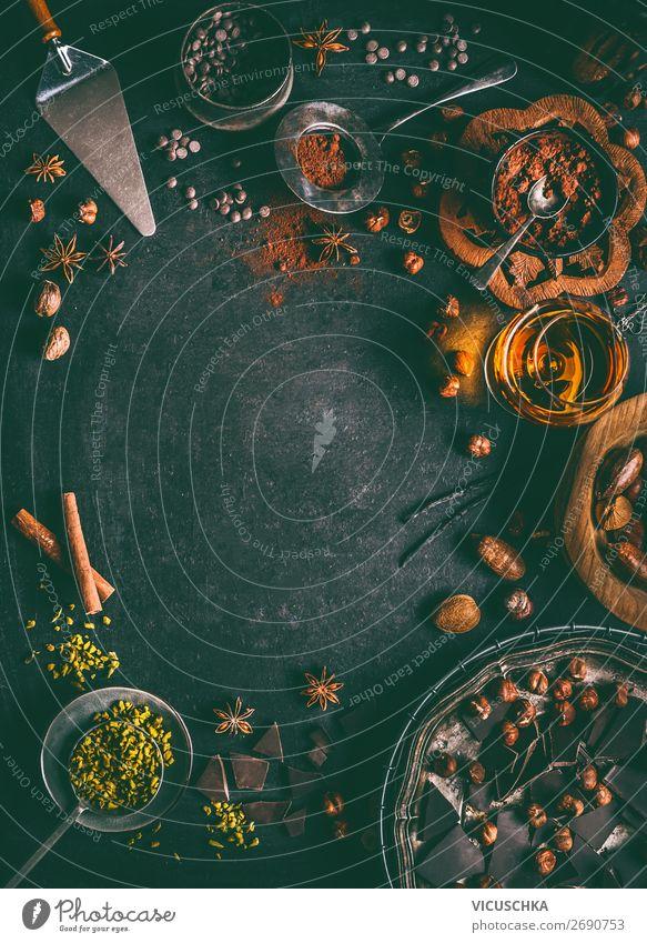 Schokolade Hintergrund mit Nüssen und Wintergewürze Lebensmittel Kräuter & Gewürze Ernährung Geschirr Stil Design Tisch Weihnachten & Advent Tradition