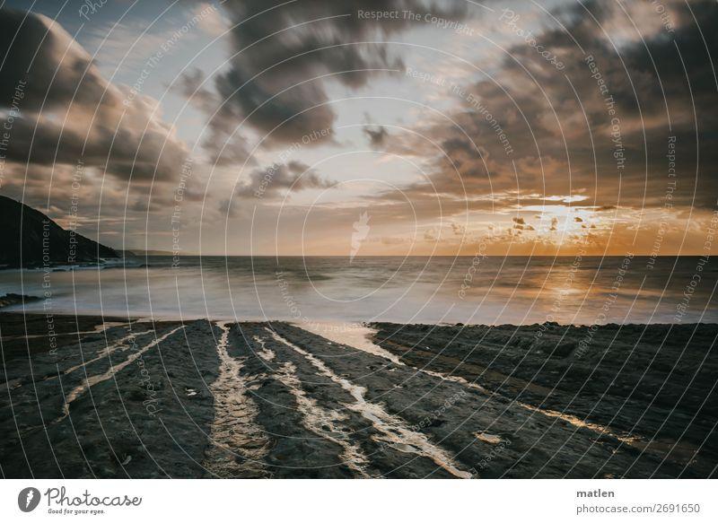 Sommerabend Umwelt Natur Landschaft Himmel Wolken Horizont Sonnenaufgang Sonnenuntergang Schönes Wetter Felsen Küste Strand Bucht Meer exotisch maritim blau