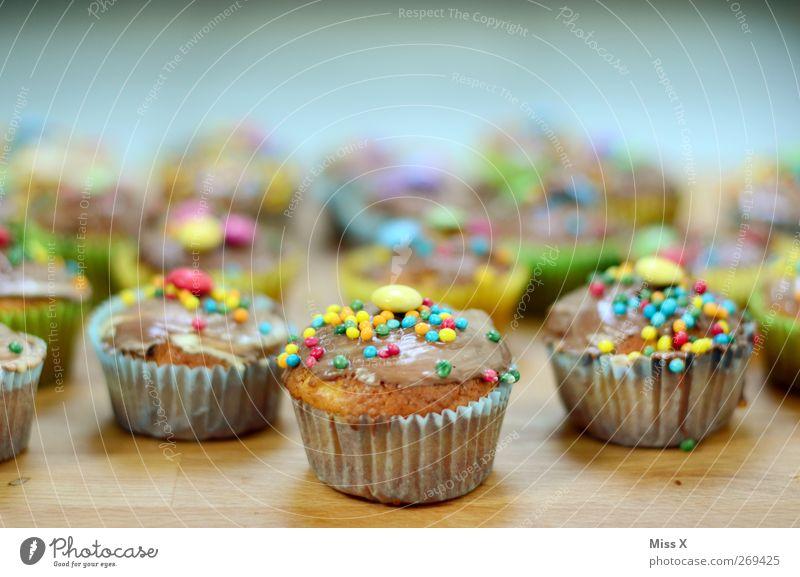 Armee Lebensmittel Teigwaren Backwaren Kuchen Süßwaren Schokolade Ernährung Kaffeetrinken klein lecker süß mehrfarbig Muffin Bäckerei Zuckerperlen Farbfoto