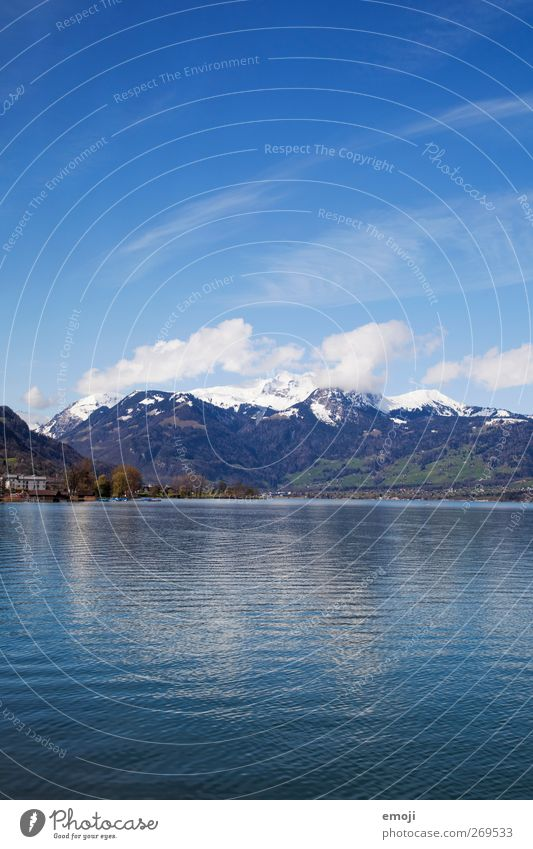 blauer als die Schweiz erlaubt Umwelt Natur Landschaft Himmel Wolkenloser Himmel Schönes Wetter Hügel Berge u. Gebirge Gipfel Schneebedeckte Gipfel Seeufer