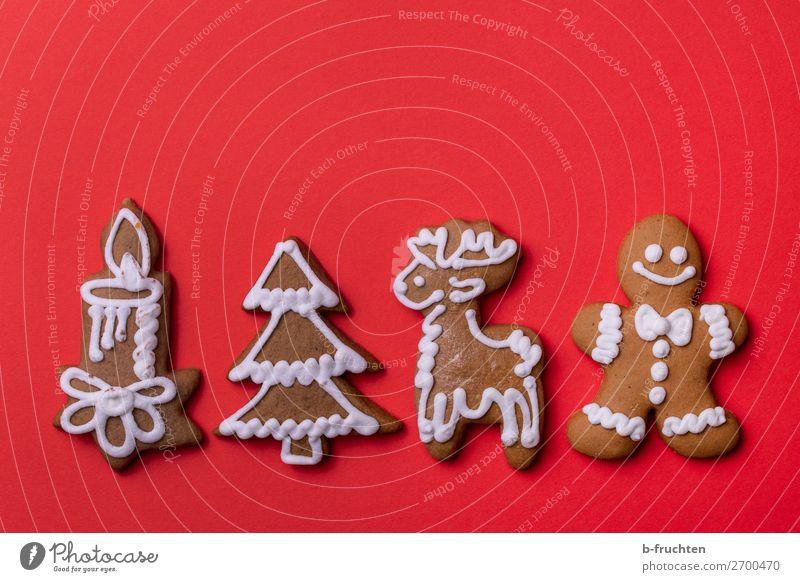 Weihnachts-Lebkuchen Weihnachten & Advent rot Essen Feste & Feiern liegen genießen Zeichen Kerze Backwaren Süßwaren wählen Figur Tanne Reihe Teigwaren