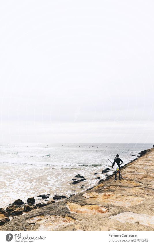Surfer at the Atlantic Ocean 1 Mensch Natur Bewegung Freiheit Atlantik Portugal Surfen Küste Sandstrand Wellengang Wolken Ferien & Urlaub & Reisen