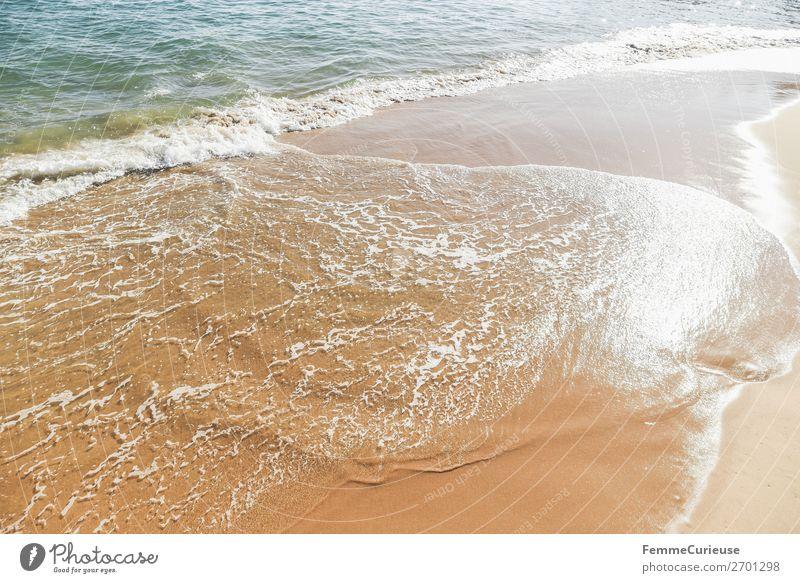 Foaming water of the Atlantic Ocean at a sandy beach Ferien & Urlaub & Reisen Natur Wasser Meer Reisefotografie Tourismus Wellen Sandstrand Portugal Atlantik