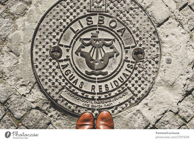 Woman standing on manhole cover in Lisbon Stadt Ferien & Urlaub & Reisen Lissabon Gully Stiefel Schuhspitze Sonnenstrahlen Symbole & Metaphern Straße