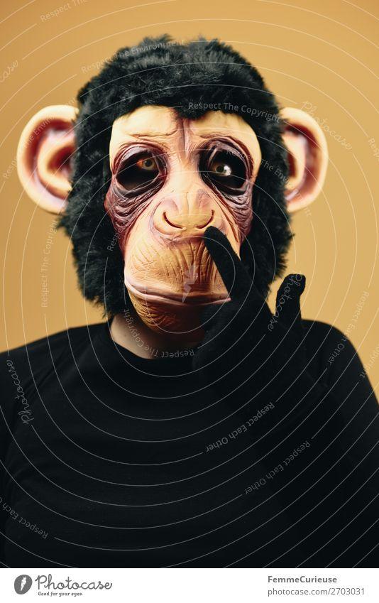 Person with monkey mask drilling into nose Tier Freude Evolution Affen Schimpansen Latex Maske Fell Nase bohren verkleidet Karneval Karnevalskostüm