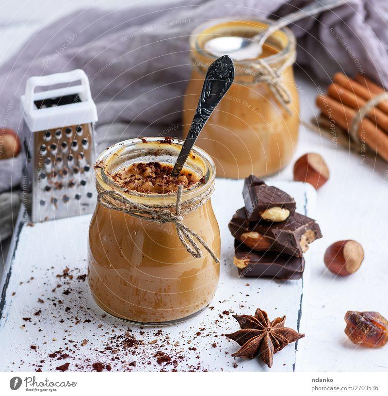 Karamell-Dessert Toffee im Glasglas Süßwaren Kräuter & Gewürze Löffel Tisch Holz frisch lecker braun Tasse Hintergrund Sahne Lebensmittel gebastelt Zutaten