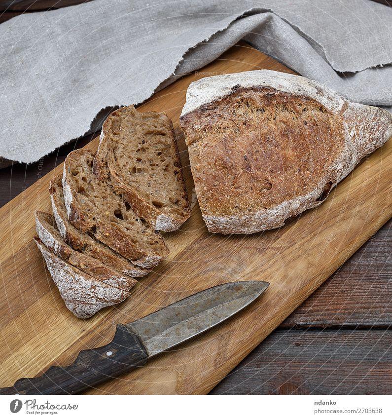 geschnittener Laib Roggenmehlbrot Brot Frühstück Tisch Holz dunkel frisch braun Mehl Gesundheit Lebensmittel Weizen ganz organisch Mahlzeit Brotlaib Korn