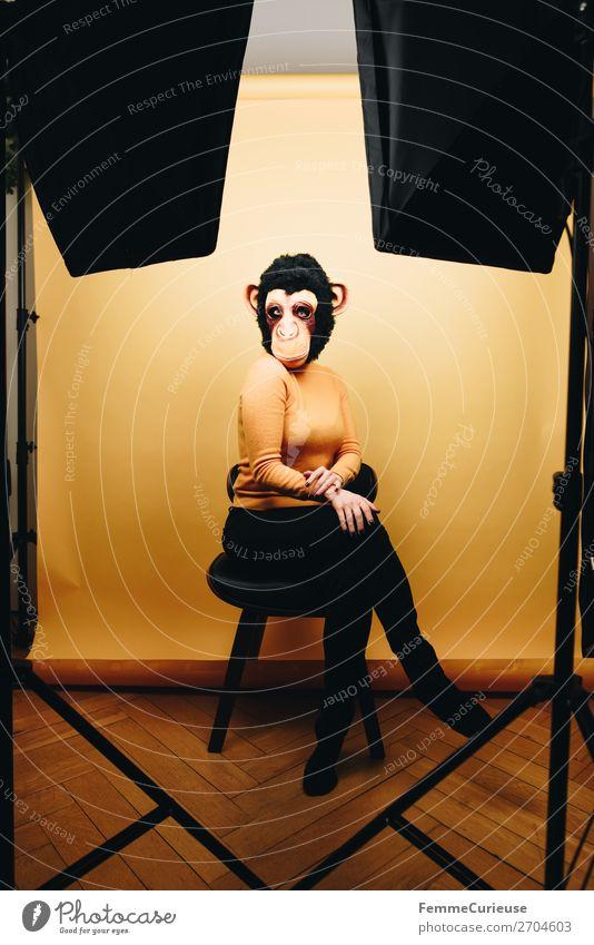 Woman with monkey mask posing in photo studio feminin Frau Erwachsene 1 Mensch 18-30 Jahre Jugendliche 30-45 Jahre Freude Fotostudio Studioaufnahme gelb
