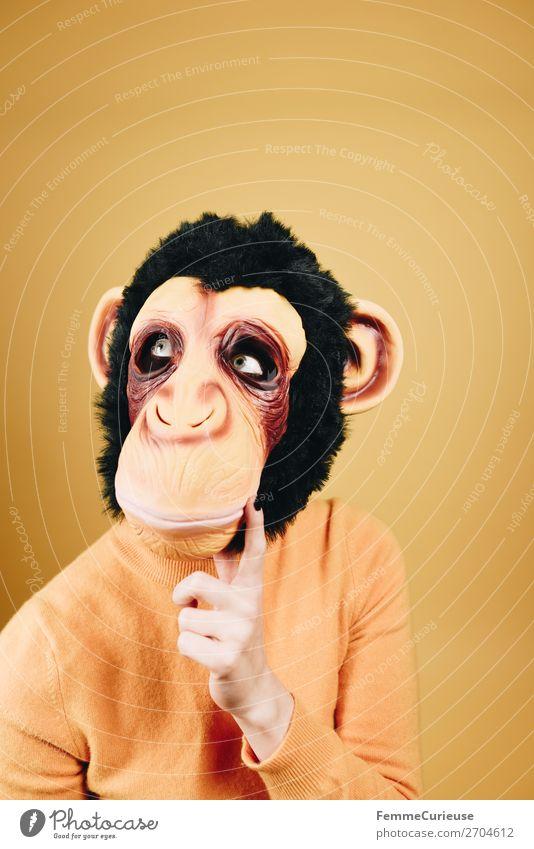 Woman with monkey mask looking thoughtful feminin Frau Erwachsene 1 Mensch 18-30 Jahre Jugendliche 30-45 Jahre Freude Karneval Karnevalskostüm Karnevalsmaske