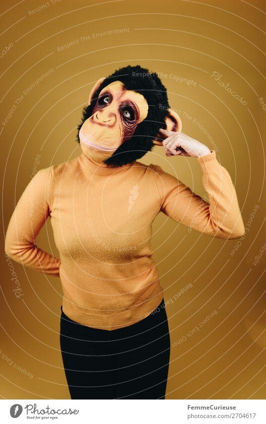 Woman with monkey mask drilling in her ear feminin Frau Erwachsene 1 Mensch 18-30 Jahre Jugendliche 30-45 Jahre Freude lustig Ohr bohren berühren Maske Karneval