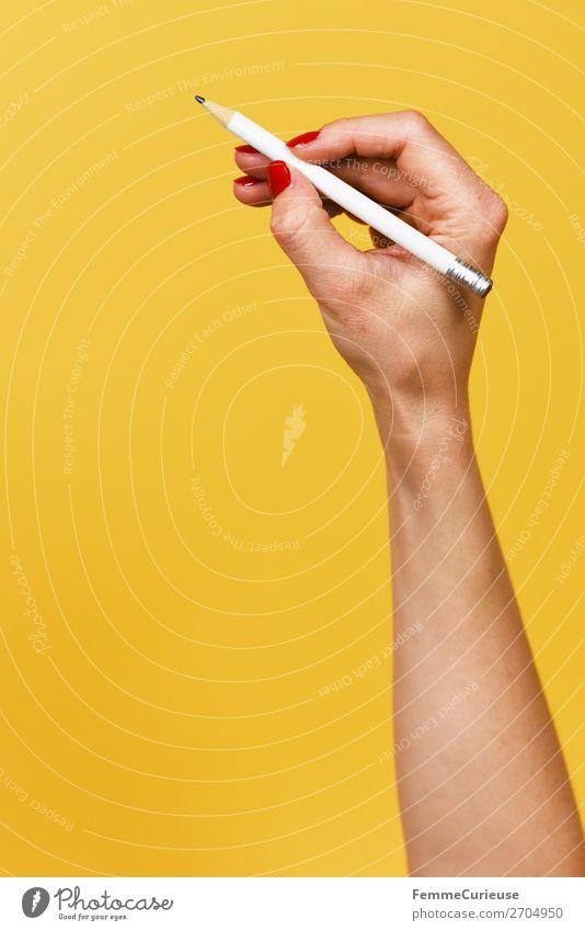 Forearm and hand with pencil against a yellow background feminin Frau Erwachsene 1 Mensch 18-30 Jahre Jugendliche 30-45 Jahre Kreativität Unterarm Gelenk
