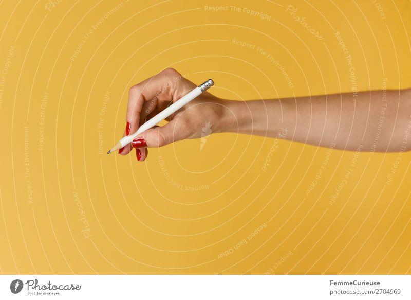 Forearm and hand with pencil against a yellow background feminin 1 Mensch Kommunizieren Hand Finger Nagellack rot gelb zeichnen schreiben Bleistift Unterarm