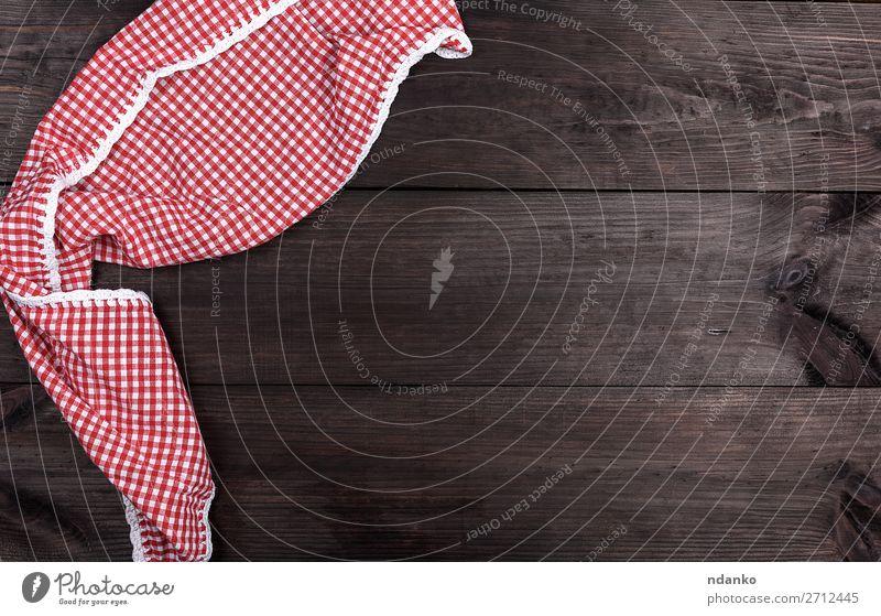 rotes Textilhandtuch in einer weißen Zelle Design Dekoration & Verzierung Tisch Küche Bekleidung Stoff Holz oben braun Farbe altehrwürdig Hintergrund blanko