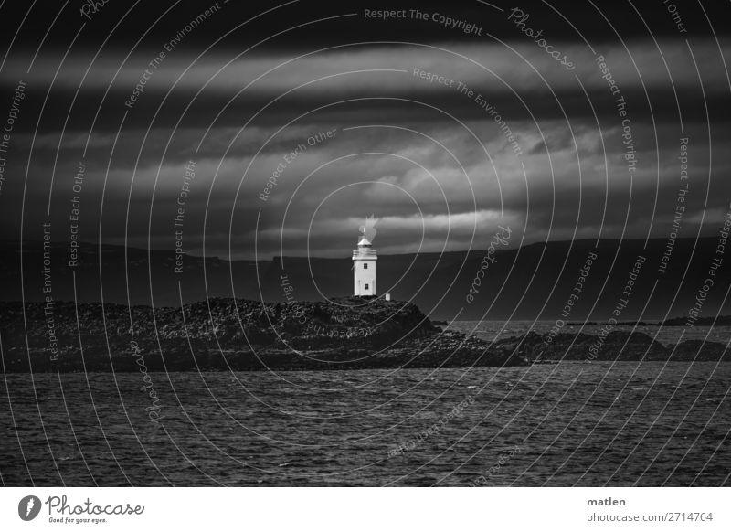 Leuchtturm Himmel Natur Landschaft Meer Wolken dunkel Frühling Küste Felsen Insel Island maritim Fjord schlechtes Wetter