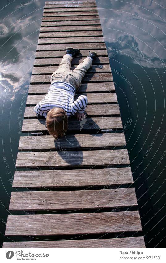 on a stairway Mensch Kind Himmel Natur blau Wasser Ferien & Urlaub & Reisen Sonne Sommer Freude Wolken Umwelt Junge klein Beine träumen