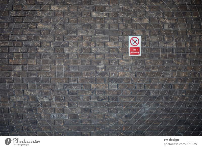 Lass Dich nicht einwickeln! Menschenleer Architektur Mauer Wand Fassade Zeichen Schriftzeichen Schilder & Markierungen Hinweisschild Warnschild nachhaltig braun