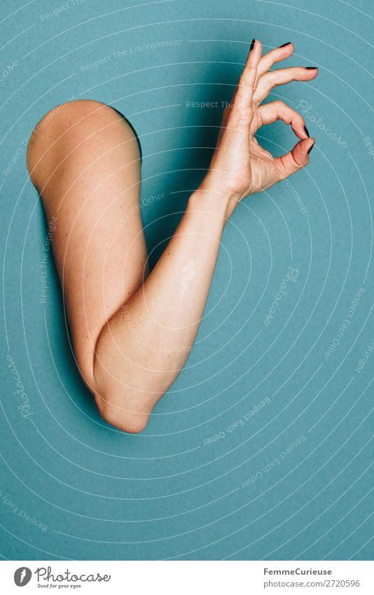 A woman's arm with her hand showing an okay sign feminin 1 Mensch Kreativität alles klar gestikulieren Finger Strukturen & Formen Zeichen Arme türkis Nagellack
