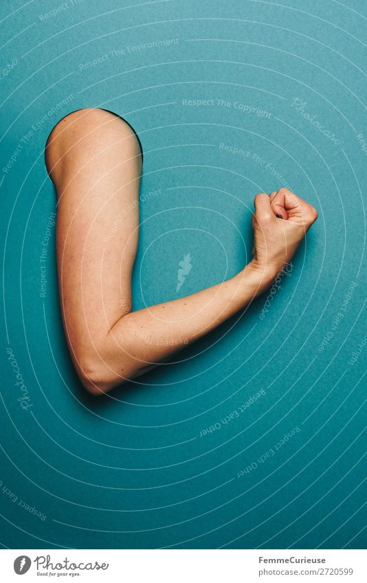 Arm of a woman with a sporty gesture feminin Frau Erwachsene 1 Mensch Schreibwaren Papier Sport Muskulatur Nervosität Spannung türkis Faust Konzentration Kreis
